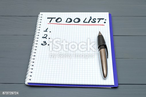 istock To do list paper page with pan on the wooden desk table surface with copy space 873729724