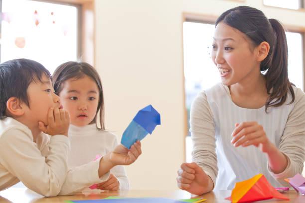 To fold the origami nursery and kindergarten stock photo