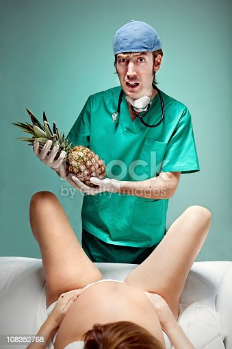 Woman giving birth to a pineapple