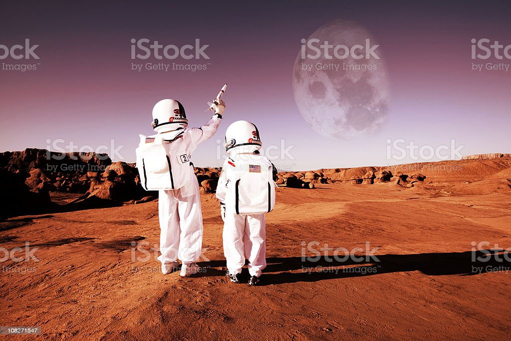 To Infinity and Beyond! Don't settle for the surface of Mars. Use your imagination to conquer the universe. 8-9 Years Stock Photo