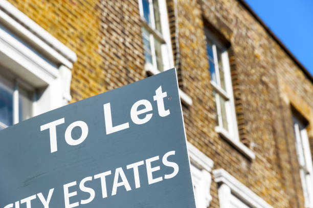 to let property agency sign posted outside english terraced houses in poplar, east london - tenant stock photos and pictures