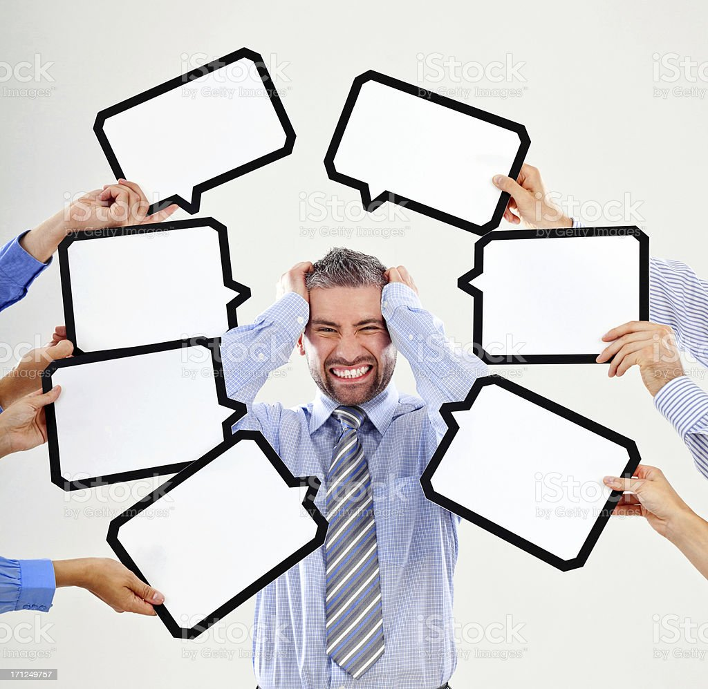 To much thoughts Portrait of angry businessman surrounded by many speech bubbles with copyspace, pulling his hair out. 30-34 Years Stock Photo