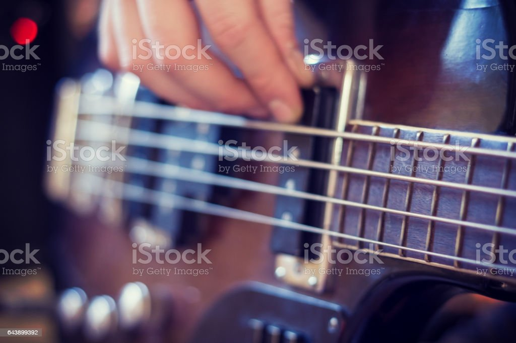To play bass guitar stock photo