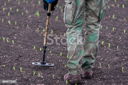 490314373 istock photo to seek treasures on earth with a metal detector 969973062