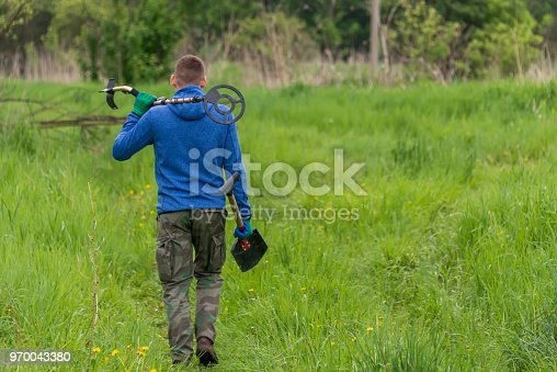 490314373 istock photo to seek treasures on earth with a metal detector 970043380