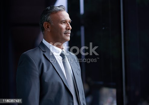 Shot of a mature businessman looking thoughtful while standing outside an office