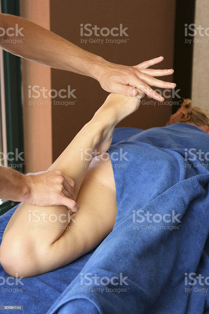 To the girl do massage of legs royalty-free stock photo