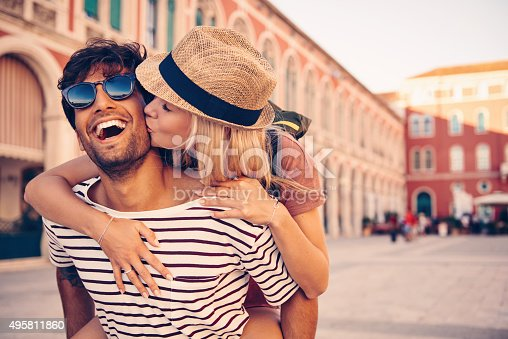 Shot of a young man piggybacking his girlfriend through a foreign cityhttp://195.154.178.81/DATA/i_collage/pu/shoots/805861.jpg