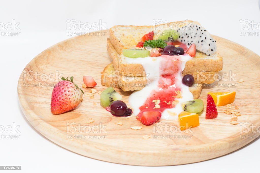 Toast and fruit total milk yogurt on white background. royalty-free stock photo
