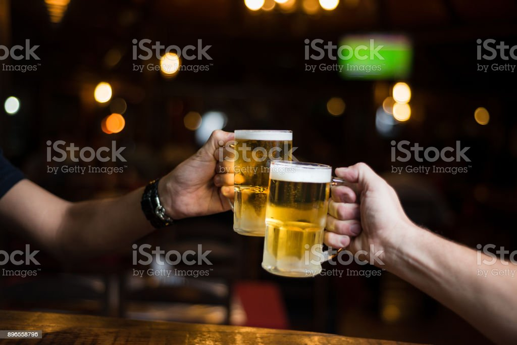 Toast beer mugs stock photo
