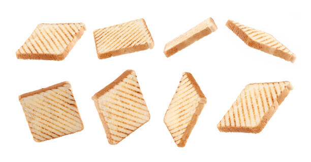 toast bread fly,float on white background toast bread float, fly with grill marks on white background Anglo American stock pictures, royalty-free photos & images