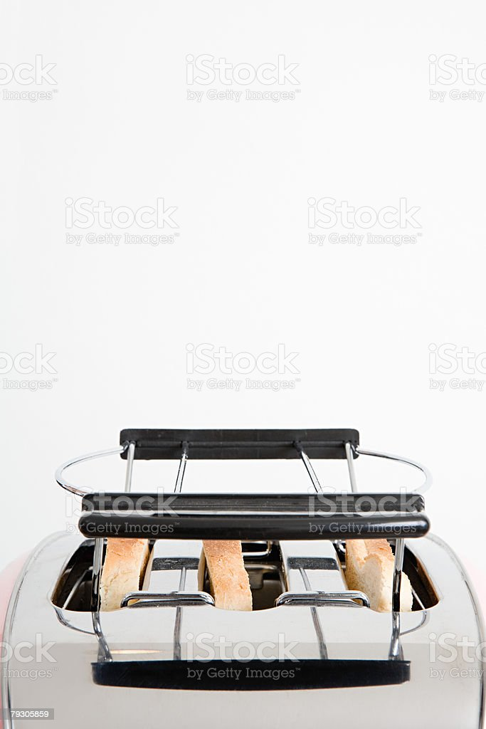 Toast in a toaster 免版稅 stock photo