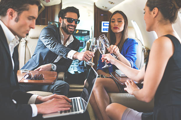 Toast in private jet airplane stock photo