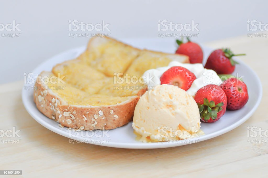 toast or bread with butter topping and ice cream royalty-free stock photo