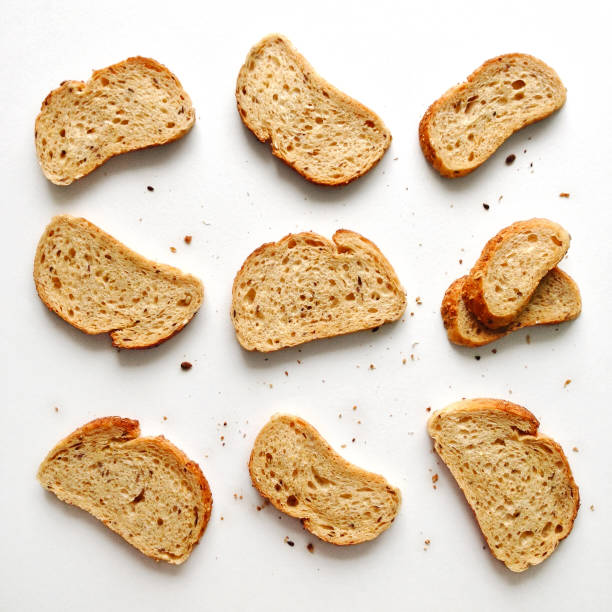 Toast pattern Set of slices toast bread isolated on a white background, flat lay top view bread stock pictures, royalty-free photos & images