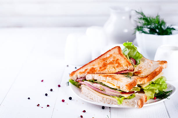 toast sandwich with sausage - club sandwich stock photos and pictures