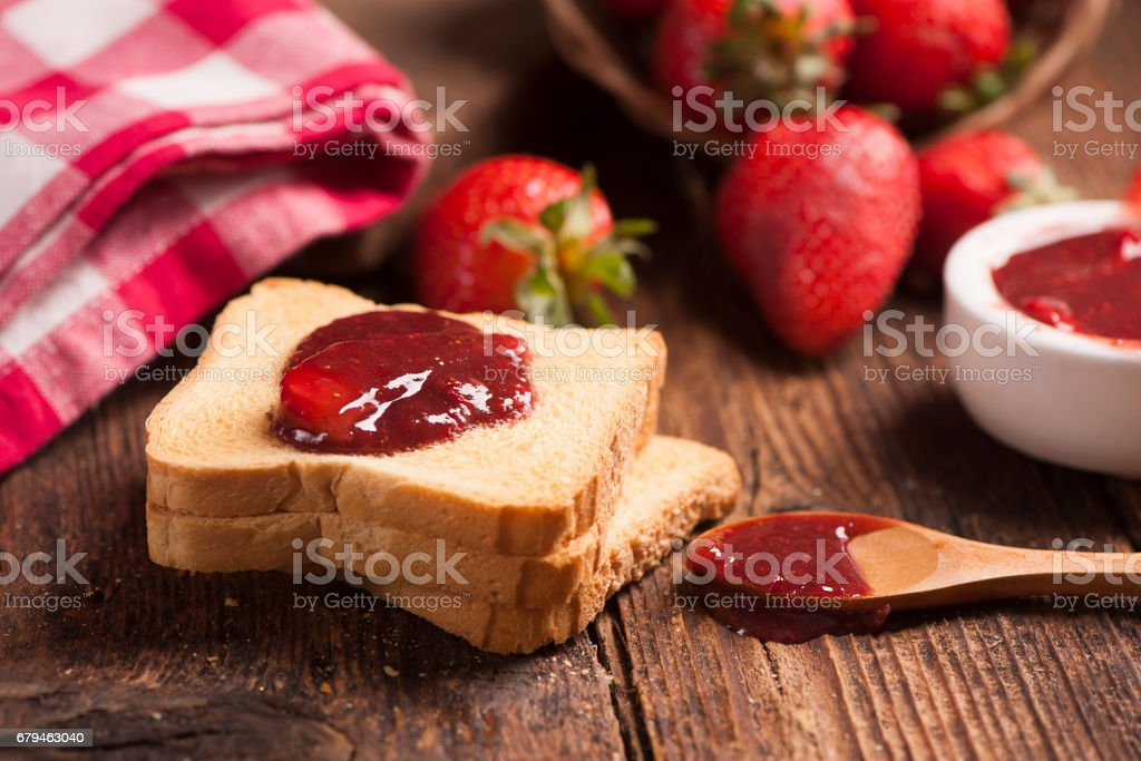 Toast snack with strawberry jam royalty-free stock photo