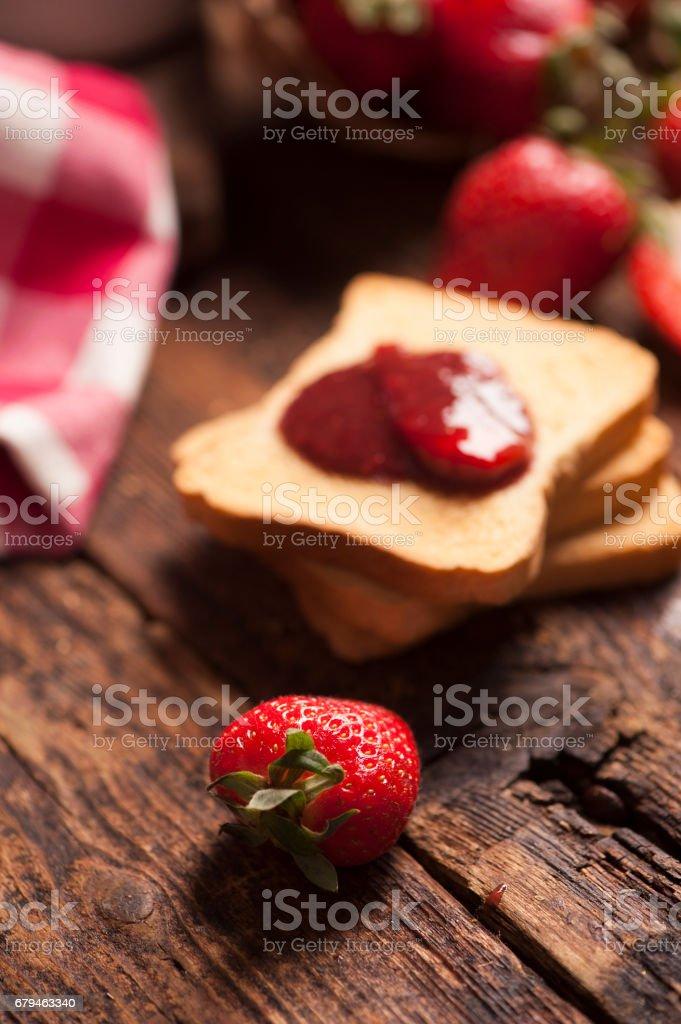 Toast snack with strawberry jam royalty-free stock photo