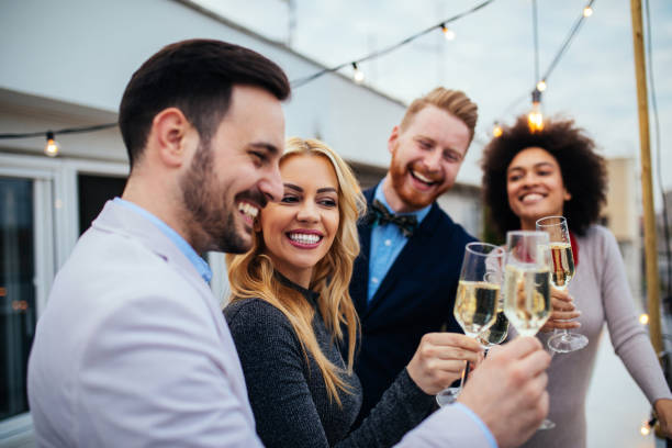 A toast to love and friendship ! Group of friends celebrating with Champagne high society stock pictures, royalty-free photos & images