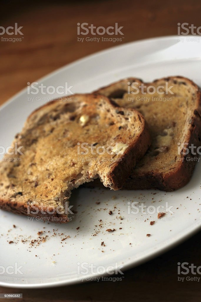 Toast with a bite out royalty-free stock photo