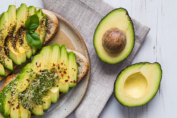 toast with avocado and cress - avokado bildbanksfoton och bilder
