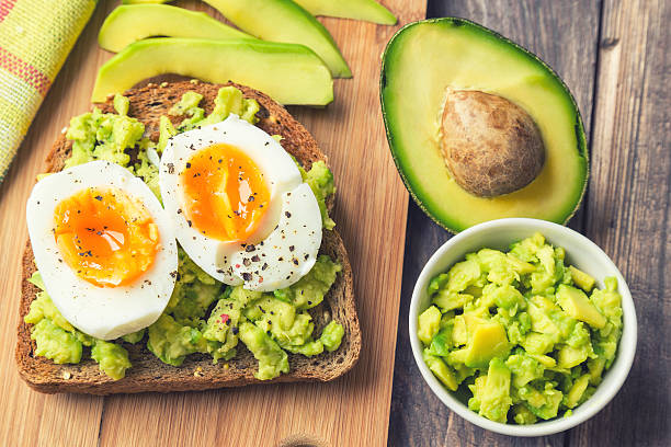 Toast with avocado and egg stock photo
