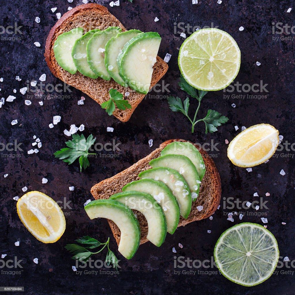 Toast with avocado on rye bread stock photo