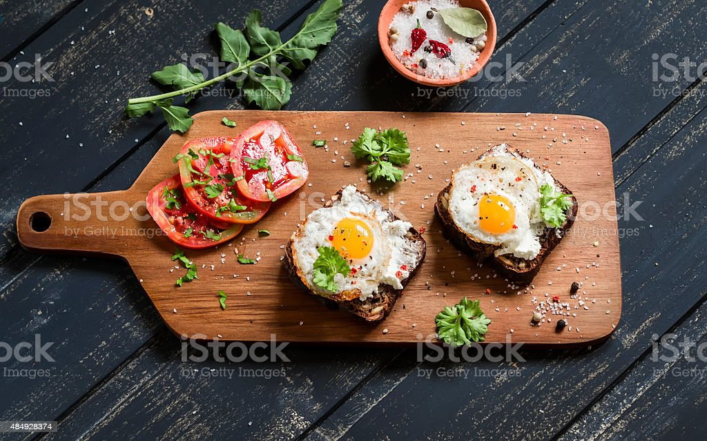 toast with feta cheese and fried quail egg stock photo