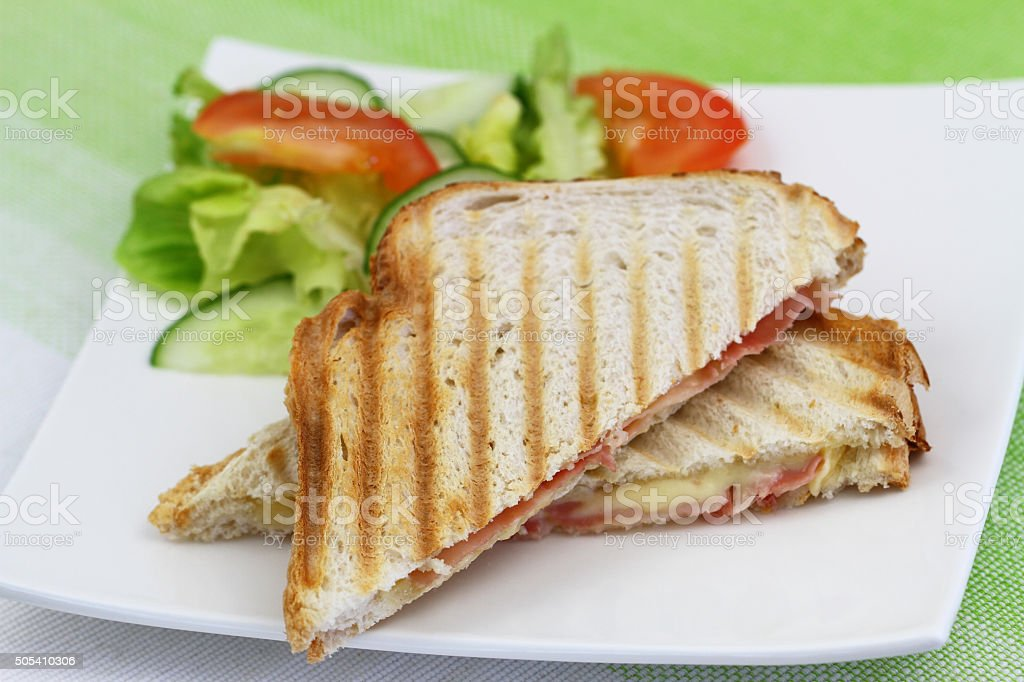 Toast with ham and cheese and green salad stock photo