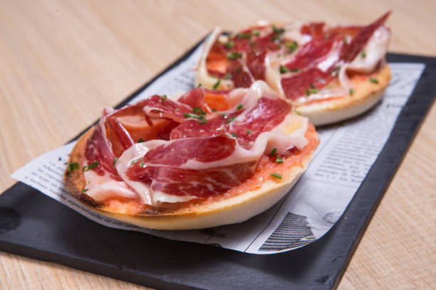 Toast with ham Spanish tostada with jamon iberico iberian stock pictures, royalty-free photos & images