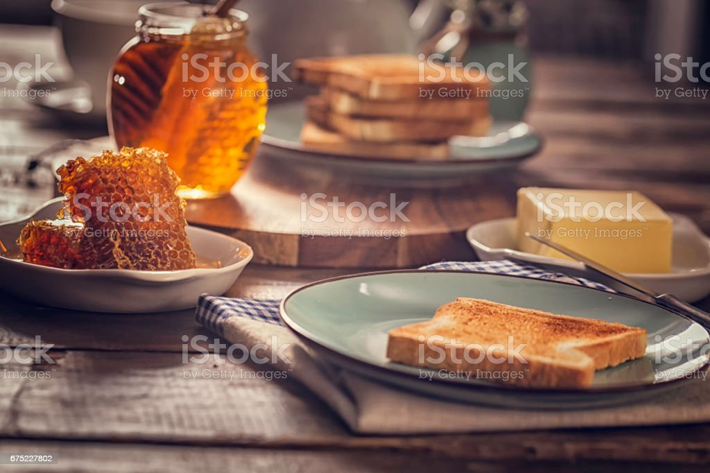 Toast with Honey for Breakfast royalty-free stock photo