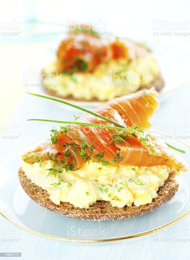 toast with scrambled eggs,salmon and chives stock photo