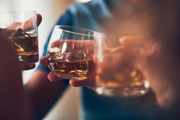 A toast with whiskey A toast with whiskey brandy stock pictures, royalty-free photos & images