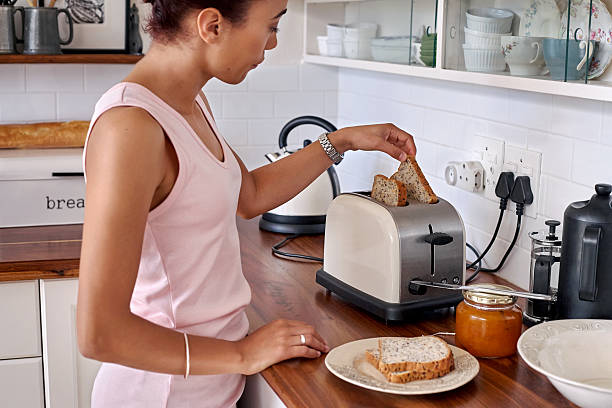 toast woman kitchen stock photo