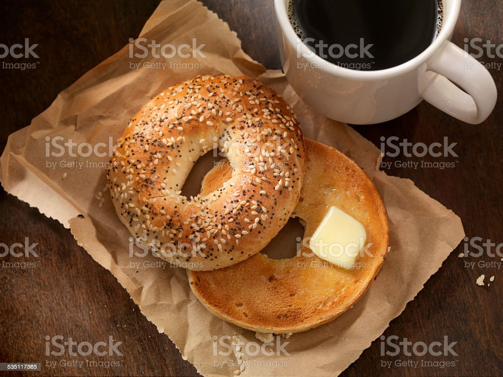 Toasted Bagel with Butter stock photo