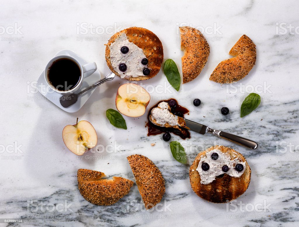 Toasted bagels with cream cheese and dark coffee for morning stock photo