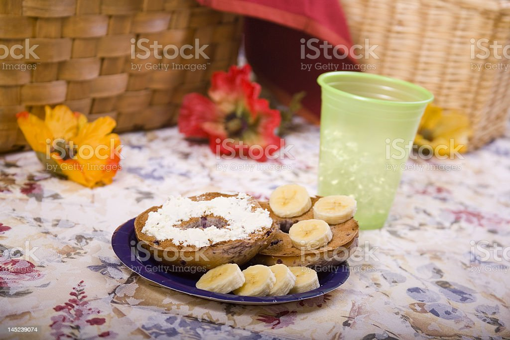 Toasted Blueberry Bagel with Sliced Bananas royalty-free stock photo