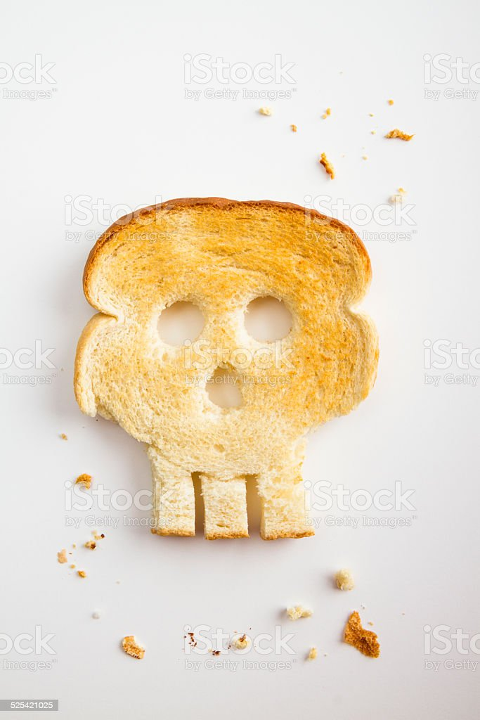 Toasted Bread Shaped Like Skull - Unhealthy Gluten Concept stock photo