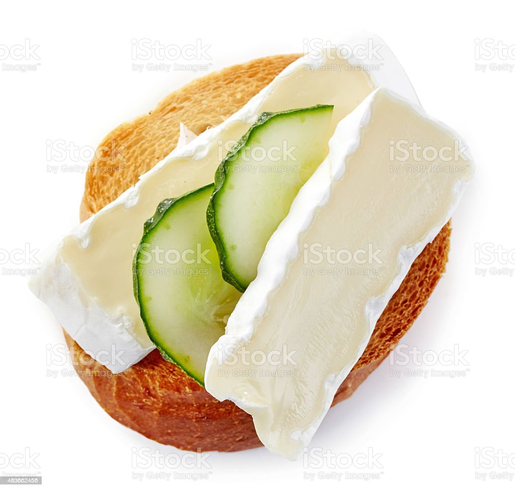 toasted bread with brie and cucumber stock photo