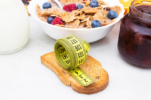 istock toasted bread with tape measure and healthy breakfast, concept of diet 1016501868