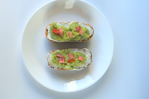 istock Toasted buns with cream cheese and guacamole 1271957161