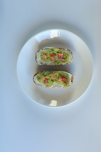istock Toasted buns with cream cheese and guacamole 1271957163