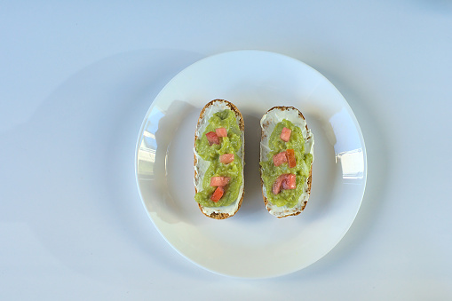 istock Toasted buns with cream cheese and guacamole 1271957165