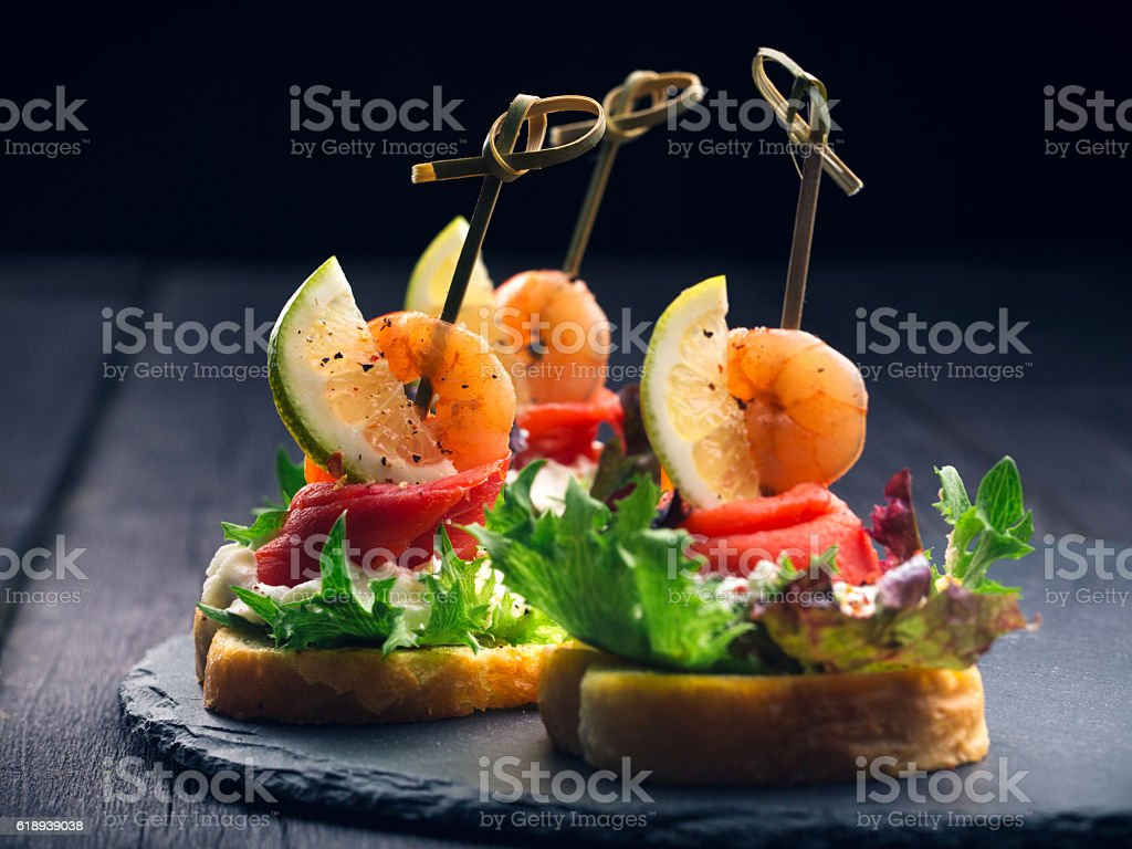 Toasted Canape with Shrimp and Salmon - foto stock