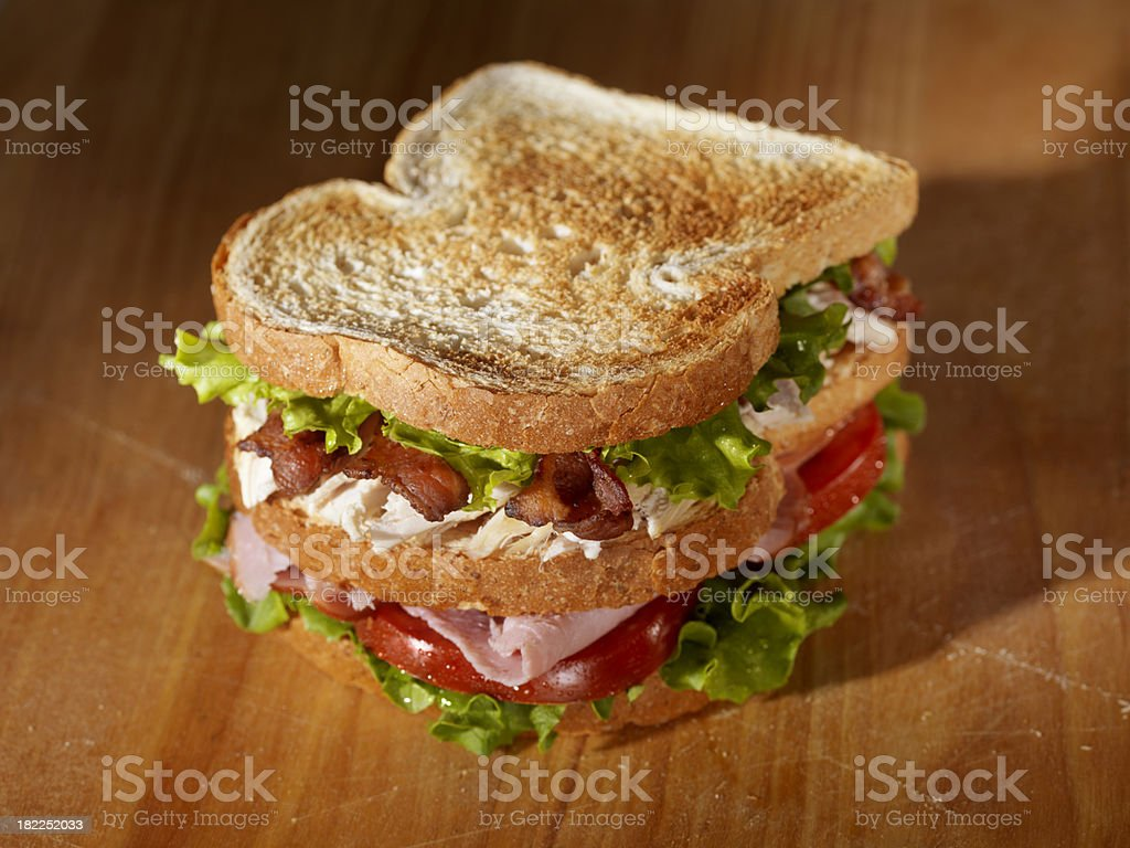 Toasted Club Sandwich on a Cutting Board royalty-free stock photo