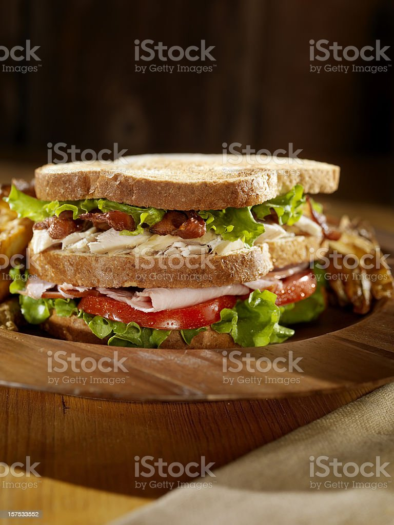 Toasted Club Sandwich with French Fries stock photo