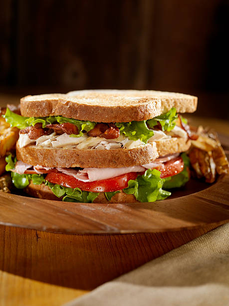 toasted club sandwich with french fries - club sandwich stock photos and pictures