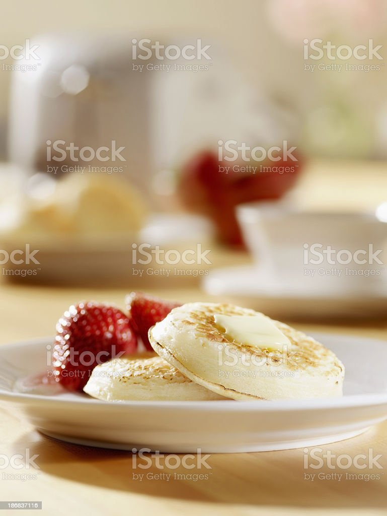 Toasted Crumpets with Melting Butter royalty-free stock photo