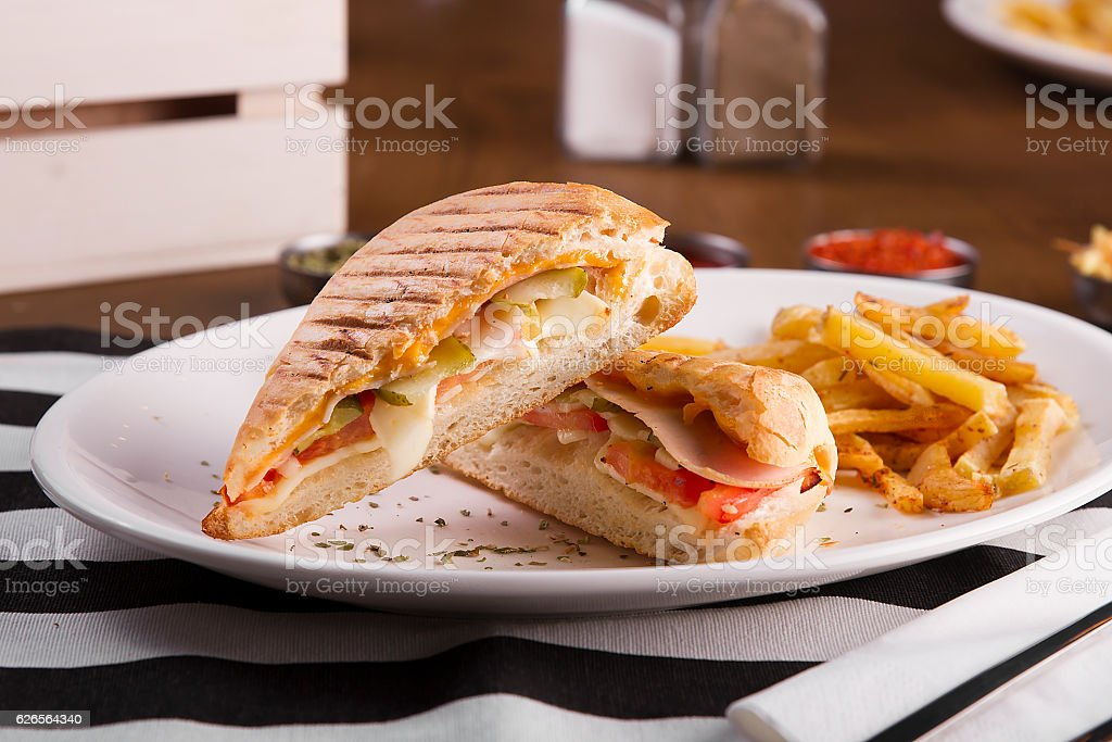 toasted, grilled cheddar cheese and turkey ham sausage sandwich toast stock photo