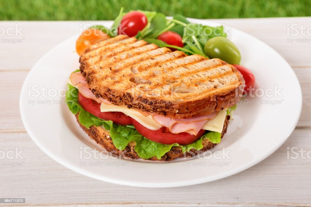 Toasted ham and cheese sandwich on wooden table royalty-free stock photo